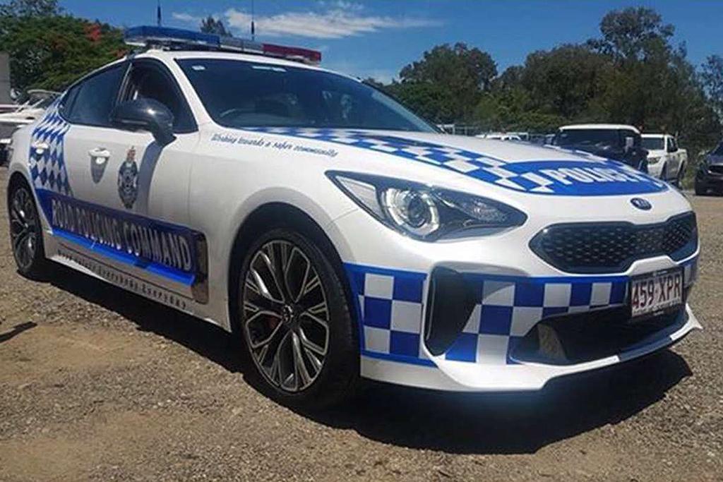 Kia Stinger pursuit cars close in - motoring.com.au