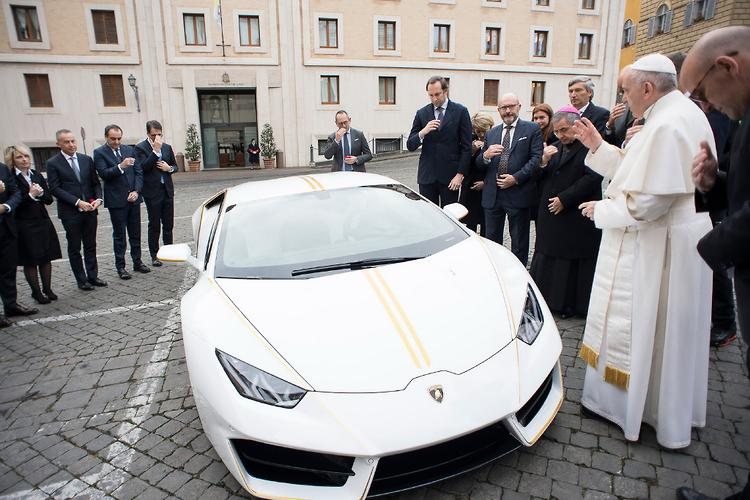 Pope Francis gives white & gold Lamborghini away to charity