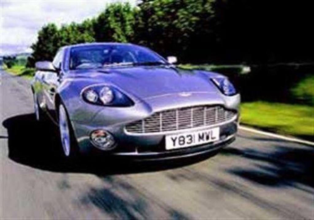 Can Ford Owned Aston Martin Produce A Front Engined Rear Drive Gt Car That Really Is Match For The 550 Maranello Enter 336kw Vanquish
